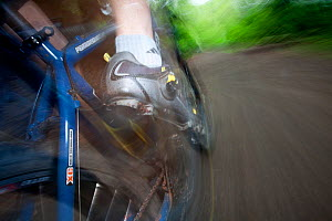 Close up on mountain biker's foot pedalling, in Cascade foothills, Washington, USA. April 2013.  -  Kirkendall-Spring