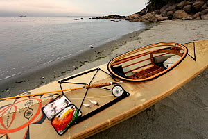 Fly fishing gear and kayak along the shore of the Strait of Juan de Fuca, Washington, USA, July 2013. - Kirkendall-Spring