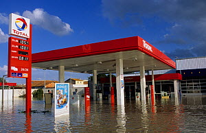 Flooded petrol station in Arles city flooded by the Rhone in December 2003. Camargue, France.  -  Jean E. Roche