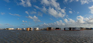 Caravans flooded by the sea on the beach of Piemanson, Arles, Camargue, France. May 2013. - Jean E. Roche