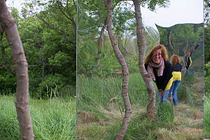Woman looking into giant 'funhouse' mirror in forest, public sculpture by Rob Mullholland, Port saint Louis du Rhone, Camargue, France, May 2013. Editorial Use only. Credit Jean Roche / Le Citron Jaun... - Jean E. Roche
