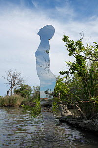 Giant mirror in the shape of a woman emerging from river, a public sculpture by Rob Mullholland, Port Saint Louis du Rhone, Camargue, France, May 2013. Editorial Use only. Credit Jean Roche / Le Citro...  -  Jean E. Roche