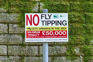 No Fly Tipping sign, Peak District, Derbyshire, England, UK, May.  -  Chris  Mattison