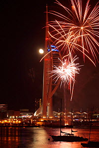 Fireworks display and full Moon over Spinnaker Tower, Gunwharf Quay, Portsmouth, Hampshire, England, UK. November 2012.  -  Peter  Lewis