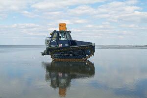 Hoylake Lifeboat's 19 tonne Talus MB-H Crawler Tractor used to launch and recover the Mersey Class Lifeboat, seen here on Hoylake Beach, Hoylake, Wirral, Merseyside, United Kingdom, March 2013. All no... - Graham  Brazendale