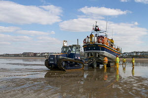 The Hoylake Lifeboat 'Lady of Hilbre', a Mersey Class Lifeboat, being placed on her trailer by the shore crew, Hoylake, Wirral, Merseyside, United Kingdom, March 2013. All non editorial uses must be c... - Graham  Brazendale