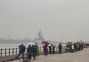 Spectators lining the promenade as Canadian warship 'HMCS Imoquois' departs following the 70th Commemoration of the Battle of the Atlantic. Seacombe, Merseyside, England UK, May 2013. All non-editoria... - Norma  Brazendale
