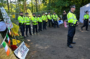 Anti-fracking protest, policemen guarding entrance to test drilling sight, Balcombe, West Sussex, England. 19th August 2013.  -  Adrian Davies