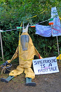 Chemical suit with signs, at anti-fracking protest, Balcombe, West Sussex, England. 19th August 2013.  -  Adrian Davies