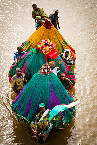 Aerial view of 'Zangbeto' guardians of the night, and priests in boat going to visit another village for voodoo / vodun ceremony, Benin, Africa, February 2011. - Christophe Courteau