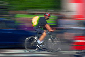 Cyclist in rush hour, Westminster, London, June 2013.  -  Ernie  Janes