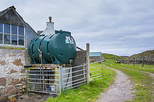 Unsecured diesel tank in isolated farmyard, Scotland, UK, May 2013.  -  Gary  K. Smith