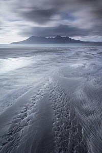 Isle of Rum at sunset viewed from Eigg, Scotland, April 2013.  -  Peter Cairns