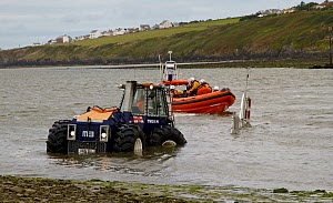 RNLI performing practice launch and recovery runs at Poppit Sands, Wales, UK, September 2013. All non-editorial uses must be cleared individually. - Norma  Brazendale