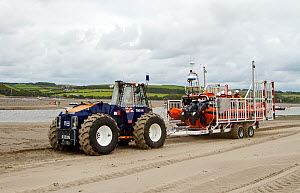 RNLI tractor towing lifeboat on trailer along the beach at Poppit Sands, Wales, UK, September 2013. All non-editorial uses must be cleared individually. - Norma  Brazendale