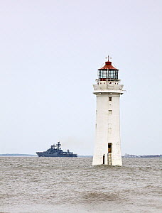 Russian destroyer Vice-Admiral Kulakov passes by New Brighton's Perch Rock lighthouse as she departs Liverpool, having represented Russia during the Battle of the Atlantic 70th Anniversary commemorati...  -  Graham  Brazendale