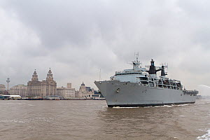 Against the backdrop of the Liverpool waterfront, HMS Bulwark proceeds up the River Mersey as it leaves Liverpool at the conclusion of the Battle of the Atlantic 70th Anniversary commemorations (BOA70...  -  Graham  Brazendale