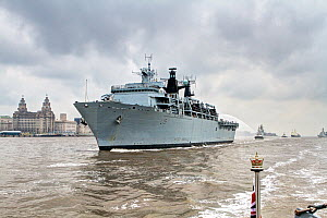 Against the backdrop of the Liverpool waterfront, HMS Bulwark leads other vessels up the River Mersey as they leave Liverpool at the conclusion of the Battle of the Atlantic 70th Anniversary commemora...  -  Graham  Brazendale