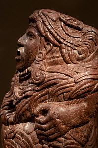 Aztec sculpture of Quetzalcoatl, a mesoamerican feathered serpent deity in human form, from 1400-1500s, Mexico,The Louvre, Paris France.  -  Roland  Seitre