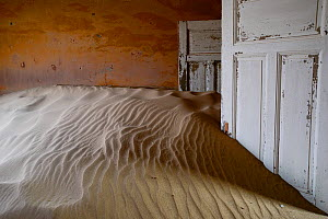 Sand filling room in Kolmanskop Ghost Town, an old diamond-mining town where shifting sand dunes have encroached abandoned houses, Namib Desert Namibia, October 2013.  -  Enrique Lopez-Tapia