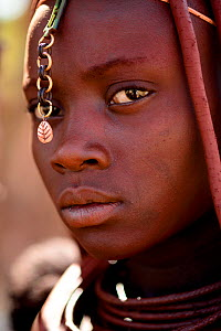 Himba woman with a metal ornament in her hair, Kaokoland, Namibia, September 2013.  -  Enrique Lopez-Tapia