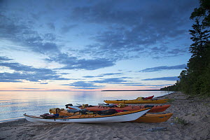 Kayaks on a beach at the edge of Lake Superior, Apostle Islands National Lakeshore, Bayfield peninsula, Wisconsin, USA, July.  -  David  Pattyn