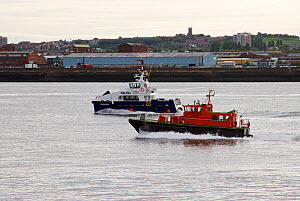 Liverpool Pilot boat 'Kittiwake' and small personnel transport vessel mid-river. Merseyside, England, UK, August 2013. All non-editorial uses must be cleared individually. - Norma  Brazendale