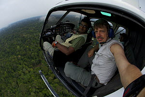 Anand Varma (left) and photographerTim Laman aboard a helicopter flying west of Yasuni National Park, Francisco de Orellana Province, Ecuador, July. - Tim  Laman