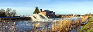 Panorama of River Parrett with massive jets of water from emergency pumps taking water off surrounding flooded fields. Near the village of Burrowbridge, Somerset Levels, Somerset, UK. January 2014. Di... - John Waters