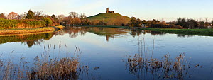 Panorama of Burrow Mump and its ruined hilltop church near Burrowbridge. In the foreground a swollen River Parrett on the right is joined by the River Tone on the left. Somerset Levels, Somerset, UK,... - John Waters