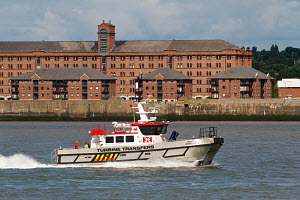 Turbine Transfers 'Porth Dinllaen', a 16 metre high speed wind farm support and crew transport vessel. River Mersey, Liverpool, Merseyside, United Kingdom, August 2013. All non-editorial uses must be... - Graham  Brazendale