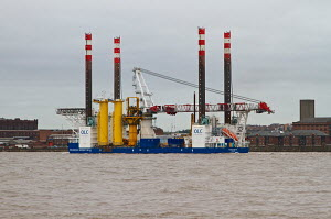 Rig platform 'Friedrich Ernestine' heading out of Liverpool on the River Mersey, Merseyside, England, UK. September 2013. All non-editorial uses must be cleared individually. - Norma  Brazendale