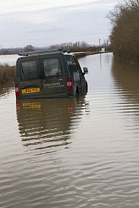 Abandoned van in flooded lane, during February 2014 flooding,  Severn valley, Gloucestershire, England, UK, 7th February 2014. Editorial use only.  -  David  Woodfall