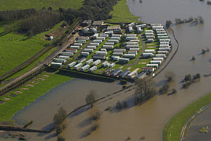 Small caravan park  surrounded by flood water from the River Severn during February 2014 flooding, Worcestershire, England, UK, 7th February 2014.  -  David  Woodfall