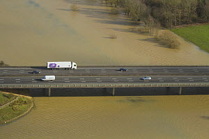 Aerial view of floods surrounding M50 motorway with bridge over River Severn, during February 2014 flooding Worcestershire, England, UK, 7th February 2014. - David  Woodfall