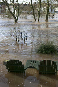 Garden table and chairs with bird feeders in flooded garden from February 2014 River Severn flood , Upton upon Severn, Worcestershire, England, UK  -  David  Woodfall