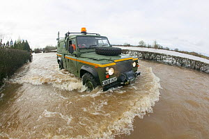 Mercia Rescue Landrover driving through flood waters to help home owners during February 2014 floods, 9th February 2014. - David  Woodfall