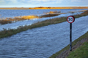 View of flooding on a coastal road after the 6th December east coast tidal surge, Cley, Norfolk, England, UK, December 2013. - Ernie  Janes
