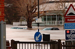 Car park flooded by River Wey, with cars almost completely submerged during Christmas 2013 flooding, Guildford. Surrey, England, UK. 25th December 2013.  -  Mark Taylor