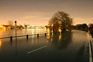 Flooded road in Weybridge along the River Thames at night. Surrey, England, 13th February 2014. - Mark Taylor