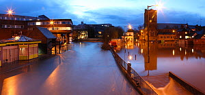 Guildford flooded by River Wey at night, during the 2013 Christmas floods. Surrey, England, 25th December 2013. Digitally enhanced image. - Mark Taylor