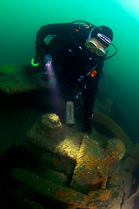 Diver on a main propellor shaft bearing on the wreck of the S.S. Serrana, sunk by UB-35 on 23 January 1918. Eastern Solent. England, UK, August 2013. - Michael Pitts