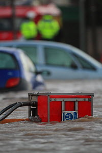Emergency services pumping floodwaters, after sea defences were breached at Splash Point in Rhyl, Denbighshire, Wales, 5th December 2013.  -  David  Woodfall