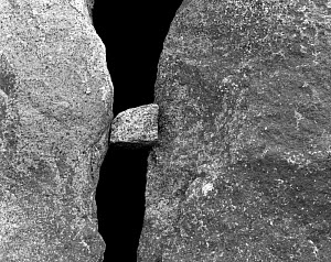 Black and white photograph of three rocks with one jammed between the other two, Washington, USA.  -  Kirkendall-Spring