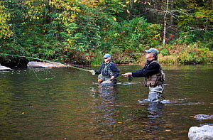 Dick Manrow and Alan McDonald fishing below Hooker Falls in DuPont State Forest, Transylvania County. North Carolina, USA, October 2013. Model released. - Kirkendall-Spring
