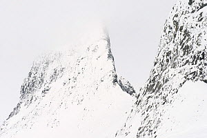Cloudy winter day at  Leirbreen, with knife edge ridge / arete, on mountain, Jotunheimen National Park, Norway, March.  -  Erlend  Haarberg