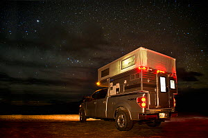 Ford F150 with popup camper, camping at night, Dubois Badlands near Dubois, Wyoming, USA, April 2012. Property released. - Jeff Vanuga