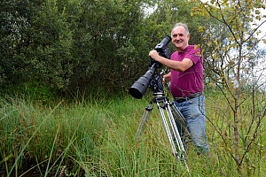 Photographer Sinclair Stammers filming pond life, Cors Caron, also known as Tregaron Bog, Ceredigion, Wales, August 2013. - Will Watson