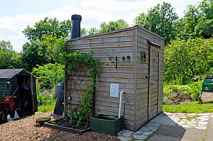 Compost toilet or lavatory with ventilation pipe showing at rear, Alexandra Palace Allotments, London Borough of Haringey, UK, June 2013. - Pat  Tuson