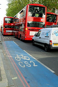 CS2 Barclay's Cycle Superhighway Route Two with red London double-decker buses close alongside, Bow Road, London Borough of Tower Hamlets, England, UK, October 2013.  -  Pat  Tuson